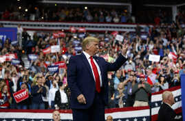 President Donald Trump arrives to speak at a campaign rally at the Target Center, Thursday, Oct. 10, 2019, in Minneapolis. (AP…