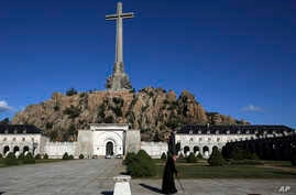 A monk walks in front of The Valley of the Fallen mausoleum near El Escorial, outskirts of Madrid, Spain, Sunday, Oct. 13, 2019…