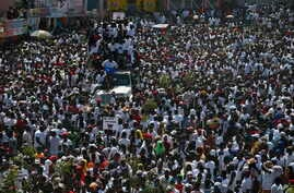 Protesters led by the art community demand the resignation of Haitian President Jovenel Moise as they march through Port-au-Prince, Haiti, Oct. 13, 2019.