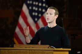 FILE - In this Oct. 17, 2019, file photo Facebook CEO Mark Zuckerberg speaks at Georgetown University in Washington. With just…