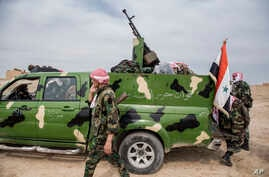 Syrian government forces deploy near the town of Tal Tamr, north Syria, Tuesday, Oct. 22, 2019. Russia and Turkey announced an…