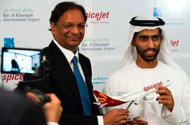 SpiceJet chairman and managing director Ajay Singh, left, and Sheikh Khalid bin Saud Al Qasimi, a son of Ras al-Khaimah ruler Sheikh Saud bin Saqr Al Qasimi, right, pose for photographs during a news conference in Ras al-Khaimah, UAE, Oct. 23, 2019.