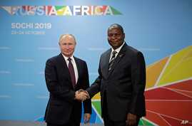 Russian President Vladimir Putin, left, and President of the Central African Republic Faustin Archange Touadera pose for a…