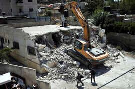 Israeli authorities demolish a Palestinian owned house in east Jerusalem, Aug. 21, 2019.