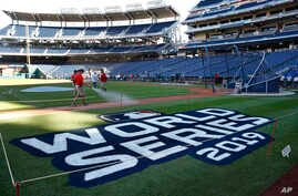 Groundskeepers prepare the infield for batting practice at Nationals Park in Washington, Thursday, Oct. 24, 2019. The Houston…
