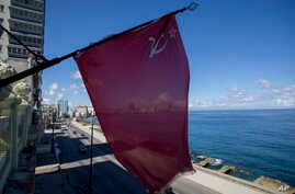 A Soviet Union flag hangs from the facade of Paladar Nazdarovie, a soviet-themed restaurant that is currently closed for repairs in Havana, Cuba, Oct. 11, 2019.