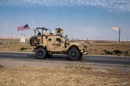 In this Monday, Oct. 28, 2019 photo, U.S. forces patrol Syrian oil fields. Pentagon is increasing U.S. efforts to protect Syria…