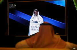 Participants watch Saudi Energy Minister Prince Abdulaziz bin Salman on a screen during his speech at the Future Investment…