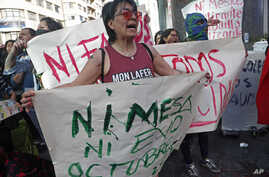 """A woman holds the Spanish message: """"Neither Mesa nor Evo in October"""" to protest the reelection of President Evo Morales, and also protest rival candidate, former President Carlos Mesa, in La Paz, Bolivia, Oct. 30, 2019."""