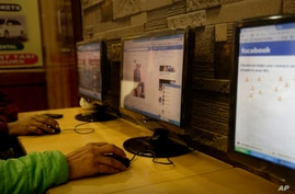 An Indian man surfs a Facebook page at an Internet cafe in New Delhi, India, Tuesday, Feb. 9, 2016. India's telecoms regulator…