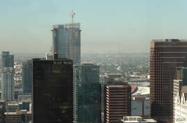 A photo of downtown Los Angeles skyline with the towering Oceanwide Plaza seen in the back with the crane. The Beijing based developer Oceanwide Holdings suspended the L.A. project in January and only a trickle of work has been spotted since then.