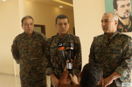 SDF general commander Mazloum Abdi, center, speaks during a press conference in Kobani, Syria, July 22, 2019. (S. Kajjo/VOA video grab)