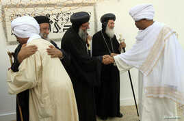 FILE - Sudan's Coptic priests (in black) welcome Muslim guests in Khartoum.