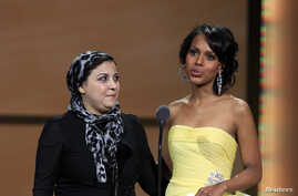FILE - Actress Kerry Washington presents Egyptian activist Esraa Abdel Fattah with a Woman of the Year award during the 21st annual Glamour Magazine Women of the Year award ceremony in New York November 7, 2011.