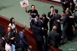 Hong Kong Chief Executive Carrie Lam leaves after her annual policy address was cancelled due to protests by pro-democracy…