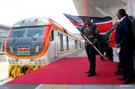 Kenya's President Uhuru Kenyatta flags off the train linking Nairobi and Naivasha at the Nairobi Terminus operating the…