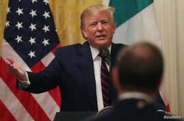 U.S. President Donald Trump speaks with ABC TV reporter Jonathan Karl during a joint news conference with Italy's President…