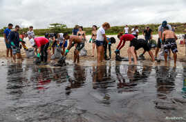 People work to remove an oil spill on Suape beach in Cabo de Santo Agostinho, Pernambuco state, Brazil October 20, 2019…