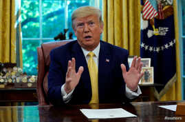 FILE PHOTO: U.S. President Donald Trump speaks during a meeting with China's Vice Premier Liu He in the Oval Office at the…