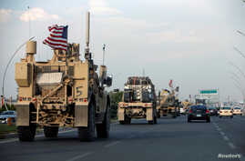 A convoy of U.S. vehicles is seen after withdrawing from northern Syria, in Erbil, Iraq October 21, 2019. REUTERS/Azad Lashkari…