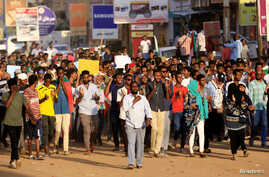 Sudanese protesters chant slogans during a rally calling for the former ruling party to be dissolved and for ex-officials to be…