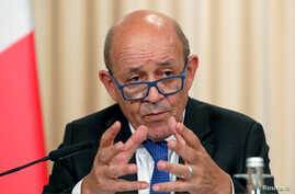 FILE PHOTO: French Foreign Minister Jean-Yves Le Drian gestures as he speaks after a meeting of the Russian-French Security Cooperation Council in Moscow, Sept. 9, 2019.