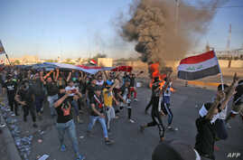 Iraqi protesters take part in a demonstration against state corruption, failing public services, and unemployment, in the Iraqi capital Baghdad's central Khellani Square, Oct. 4, 2019.