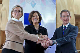 (L-R) EU Ambassador for Colombia Patricia Llombart, EU Director for Development Coordination in Latin America Jolita Butkeviciene and Colombian presidential advisor Emilio Archila in a sign of unity during a press conference in Bogota, Oct. 24, 2019.