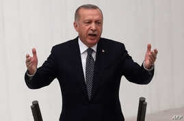 Turkish President Recep Tayyip Erdogan gestures as he delivers a speech during the opening of the third legislative session of the Turkish parliament's 27th term, at the Grand National Assembly of Turkey in Ankara, Oct. 1, 2019. 	Turkish President Recep Tayyip Erdogan gestures as he delivers a speech during the opening of the third legislative session of the Turkish parliament's 27th term, at the Grand National Assembly of Turkey in Ankara, Oct. 1, 2019.