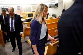 Fired Dallas police officer Amber Guyger leaves the courtroom after a jury finds her guilty of murder of Botham Jean, in Dallas, Texas, Oct. 1, 2019.