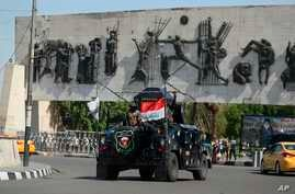 An Iraqi security forces vehicle arrives near the site of days of protests in Tahrir square, central Baghdad, Iraq, Oct. 5, 2019, after a curfew was lifted in the Iraqi capital Saturday.