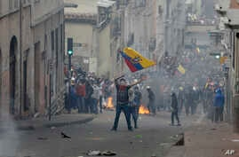 A protester waves an Ecuadorean national flag during clashes in downtown Quito, Ecuador, Oct. 9, 2019.
