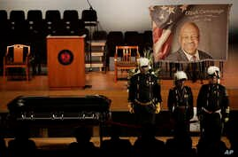 Masonic guards stand near the casket of the late U.S. Rep. Elijah Cummings during a viewing service at Morgan State University, Oct. 23, 2019, in Baltimore.