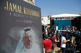 A picture of slain Saudi dissident and Washington Post columnist Jamal Kashoggi is seen during a ceremony near Saudi Arabia's consulate in Istanbul, Turkey, marking the one-year anniversary of his death, Oct. 2, 2019.