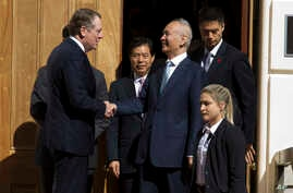 Chinese Vice Premier Liu He shakes hands with U.S. Trade Representative Robert Lighthizer, left, after a ministerial-level trade meeting at the Office of the United States Trade Representative, in Washington, Oct. 11, 2019.