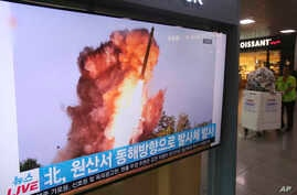 A TV screen shows a file image of a North Korea's missile launch during a news program at the Seoul Railway Station in Seoul, South Korea, Oct. 2, 2019.