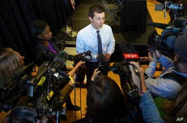 Democratic presidential candidate Pete Buttigieg speaks to the media following a panel discussion at a campaign stop, in Nashua, New Hampshire, Oct. 24, 2019.