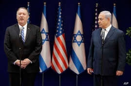 U.S. Secretary of State Mike Pompeo, left, and Israeli Prime Minister Benjamin Netanyahu stand during statements to the press during a meeting at the Prime Minister's residence in Jerusalem, Oct. 18, 2019.