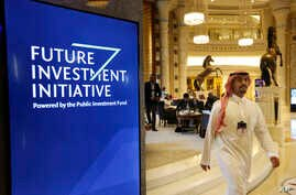 A participant at the Future Investment Initiative walks in the Ritz Carlton Hotel a day before the event, in Riyadh, Saudi Arabia, Oct. 28, 2019.