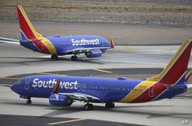 FILE - Southwest Airlines planes are seen at Phoenix Sky Harbor International Airport in Phoenix, Arizona, July 17, 2019.