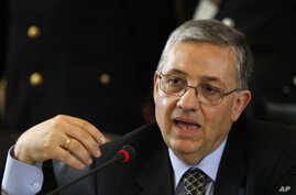FILE - Reggio Calabria prosecutor Giuseppe Pignatone gestures during a press conference at the Milan's court, Italy, July 13, 2010,