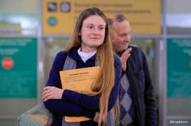 Convicted Russian agent Maria Butina, who was released from a Florida prison and then deported by U.S. immigration officials, meets with journalists upon her arrival at Sheremetyevo International Airport outside Moscow, Russia, Oct. 26, 2019.