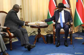 FILE - South Sudan's President Salva Kiir sits with ex-vice president and former rebel leader Riek Machar before their meeting in Juba, South Sudan, Sept. 11, 2019.