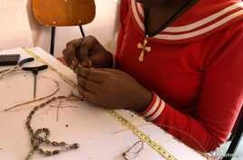 Women rescued from prostitution make jewelry from bullet casings at Ethiopian social enterprise Ellilta Products in Addis Ababa, Oct. 22, 2019.
