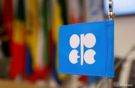 FILE - The logo of the Organization of the Petroleum Exporting Countries (OPEC) inside its headquarters in Vienna, Austria, Dec. 7, 2018.