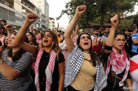 Demonstrators shout slogans during an anti-government protest in the southern city of Nabatyeh, Lebanon, Oct. 24, 2019.