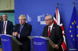 Britain's Prime Minister Boris Johnson speaks during a news conference with European Commission President Jean-Claude Juncker after agreeing on the Brexit deal, at the sidelines of the European Union leaders summit, in Brussels, Belgium, Oct. 17, 2019.