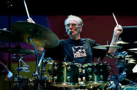 FILE - Drummer Ginger Baker of the Legendary supergroup Cream performs during a concert at the Royal Albert Hall in London, May 2, 2005.