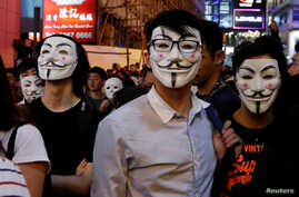 Anti-government protesters wearing costumes march during Halloween in Lan Kwai Fong, Central district, Hong Kong, Oct. 31, 2019.
