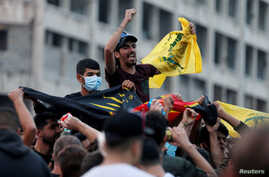 Supporters of Lebanon's Hezbollah leader Sayyed Hassan Nasrallah carry the party's flag in Beirut, Lebanon, Oct. 25, 2019.